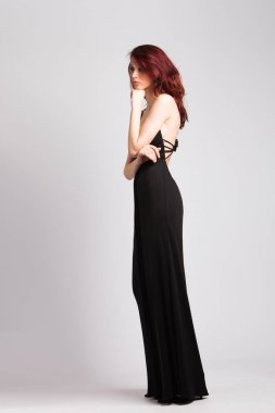red-haired girl in long black evening dress