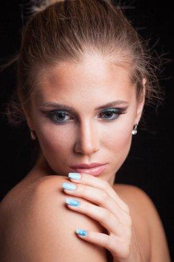 beauty young blonde woman portrait blue eyes hair in bun