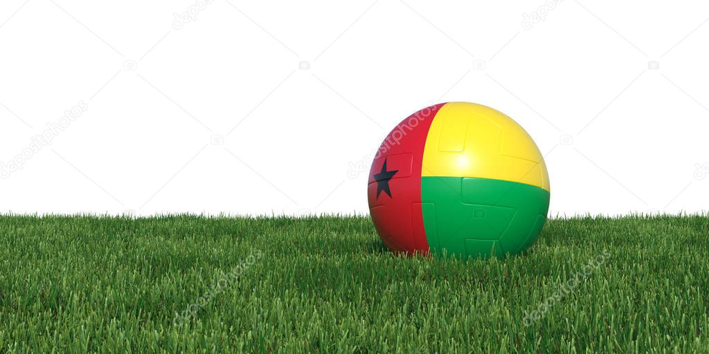 Guinea-Bissau flag soccer ball lying in grass