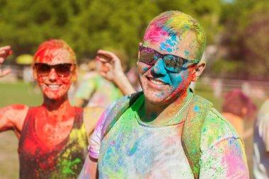 Guy with a girl celebrate holi festival, make selfie stock vector