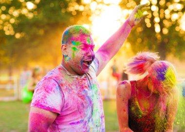 Guys with a girl celebrate holi festival stock vector