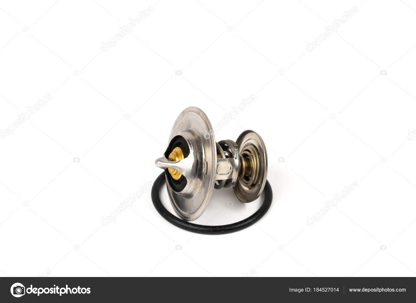 New car thermostat on a white isolated background next to a rubber ...