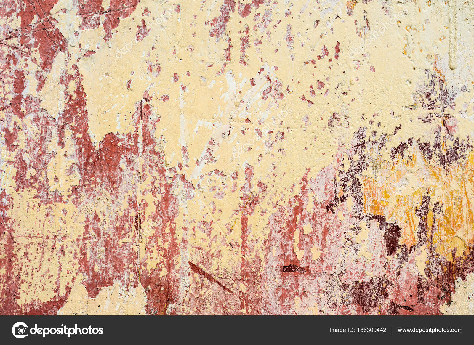 Textured background of multi layer flaking paint on the wall Mixing