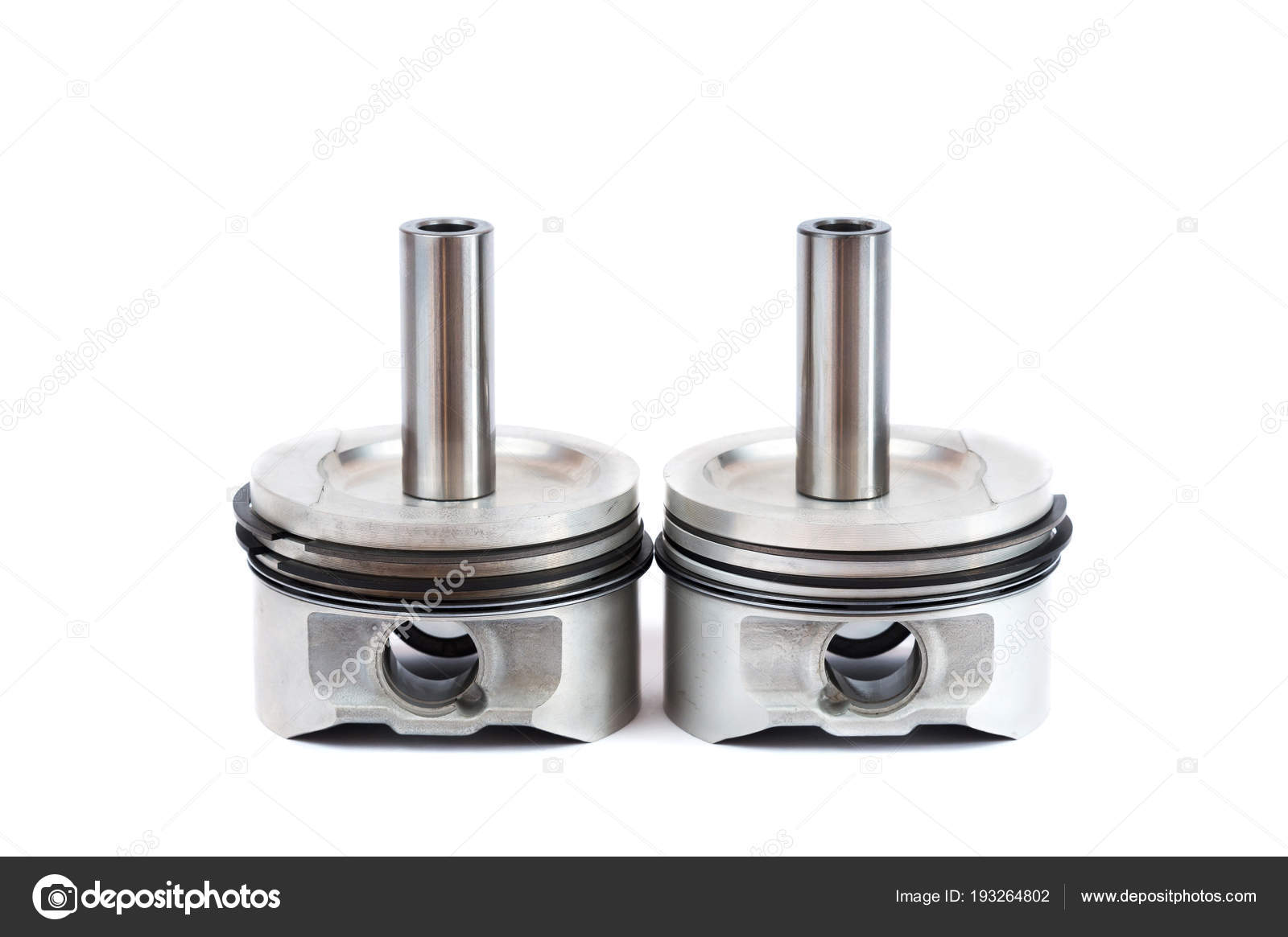 Close-up of spare parts two new pistons with connecting rods
