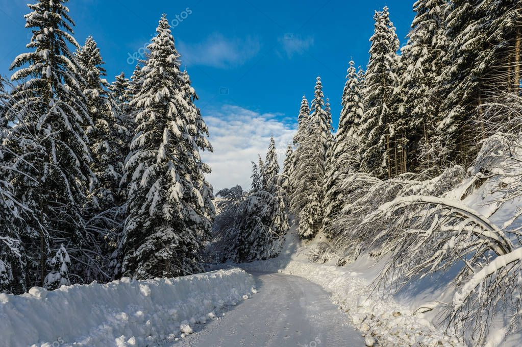 Snowy, winter landscape with Solcava panoramic road, Logarska Dolina,Slovenia.A popular tourist and travel destination.