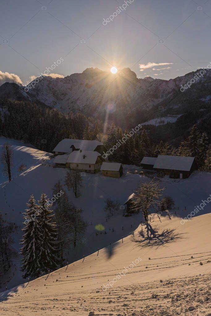 Snowy, winter landscape with farm on Solcava panoramic road, Logarska Dolina,Slovenia.A popular tourist and travel destination.