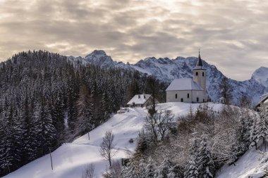 Snowy, winter landscape with Solcava panoramic road, Logarska Dolina,Slovenia.A popular tourist and travel destination. stock vector
