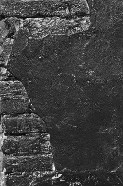 old brick wall painted black