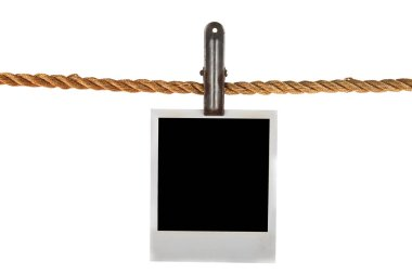 Old photo on a rope isolated on a white background