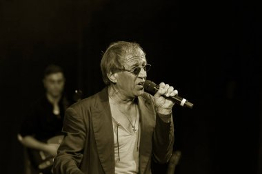 ODESSA, UKRAINE - Nov. 1, 2019: concert performance by Adriano Celentano. Soloist of the music group - Adolfo Sebastiani - famous singer, showman Celentano. Tribute Show Celentano. Italian pop legend