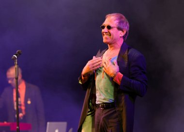 ODESSA, UKRAINE - Nov. 1, 2019: concert performance by Adriano Celentano. Soloist of the music group - Adolfo Sebastiani - famous singer, showman Celentano. Tribute Show Celentano. Italian pop legend