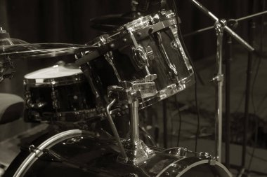 Musical background. big drum on stage. Concert Drum set on stage lighting. Live music. A concert and a band on stage. Festival and show