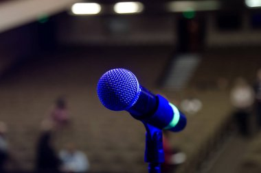 Stage microphone on stage in front of the hall. Performance on stage. Close up microphone in a concert hall or conference room