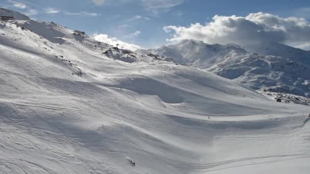 Skiers on piste going downhill