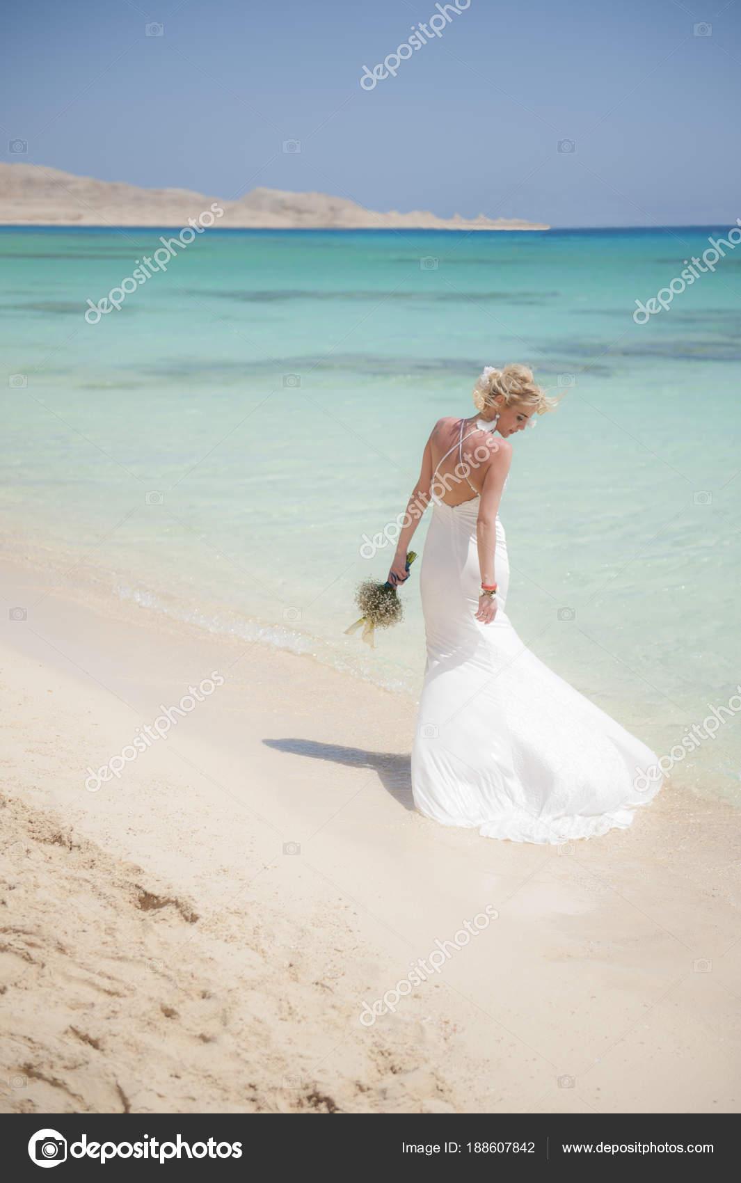 Beautiful Bride On A Tropical Beach Wedding Day Stock Photo