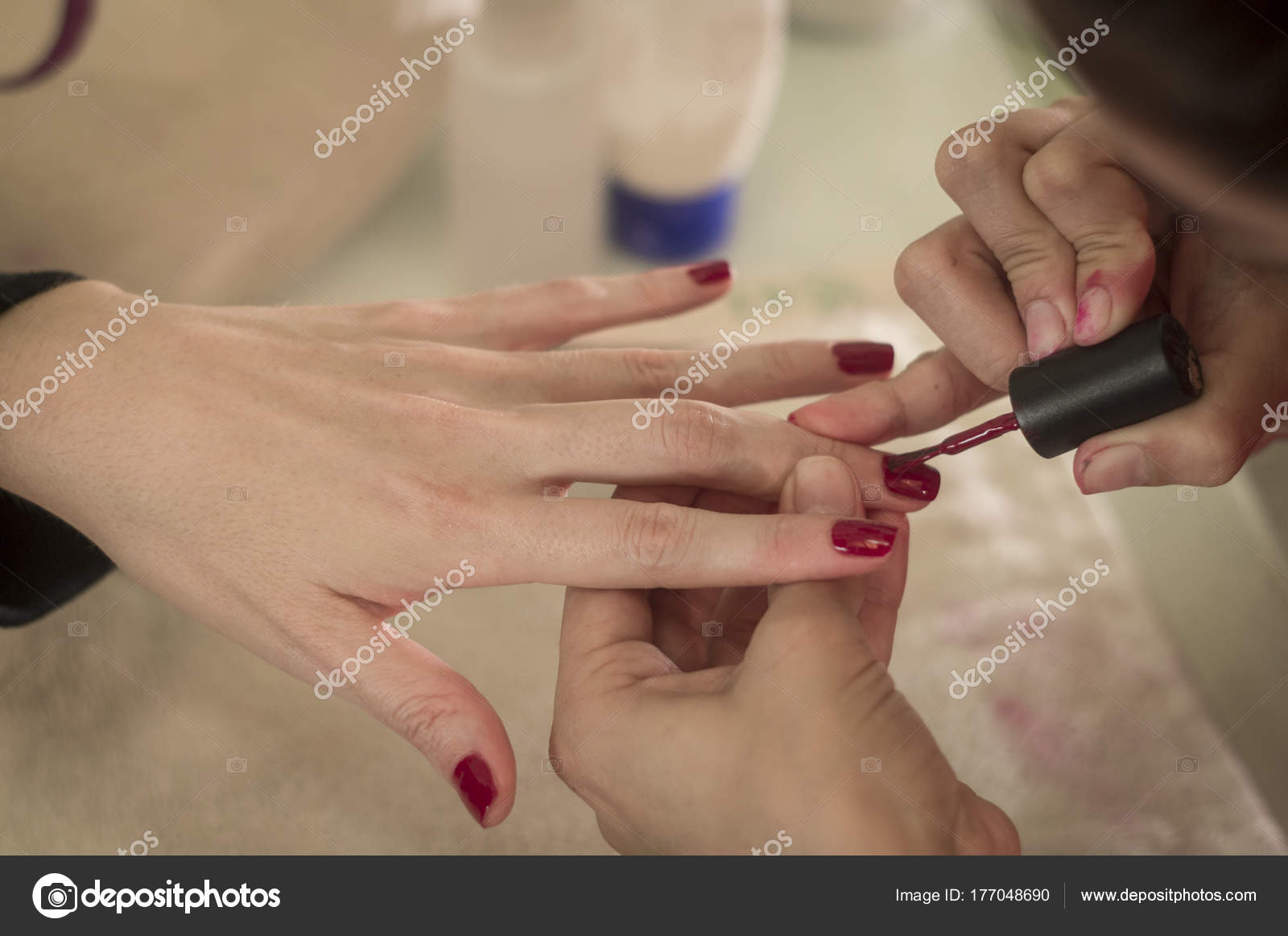 White and beautiful hands, with red nails, thin and long fingers ...