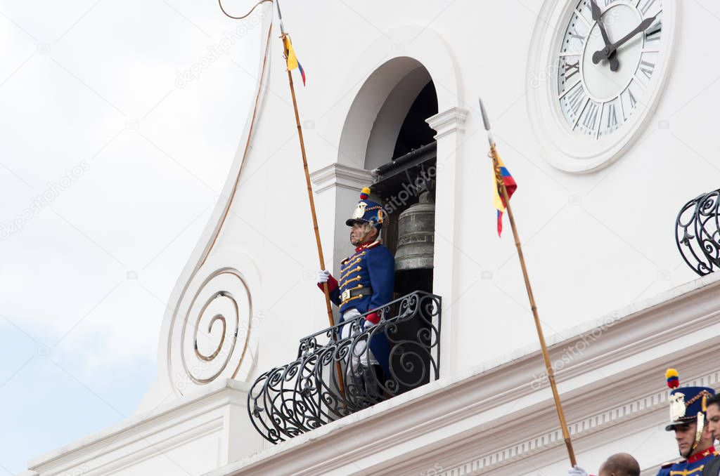 Quito, Ecuador - October 27, 2015:An unidentified man over the balcony of the Presidential palace during the weekly changing of the guards