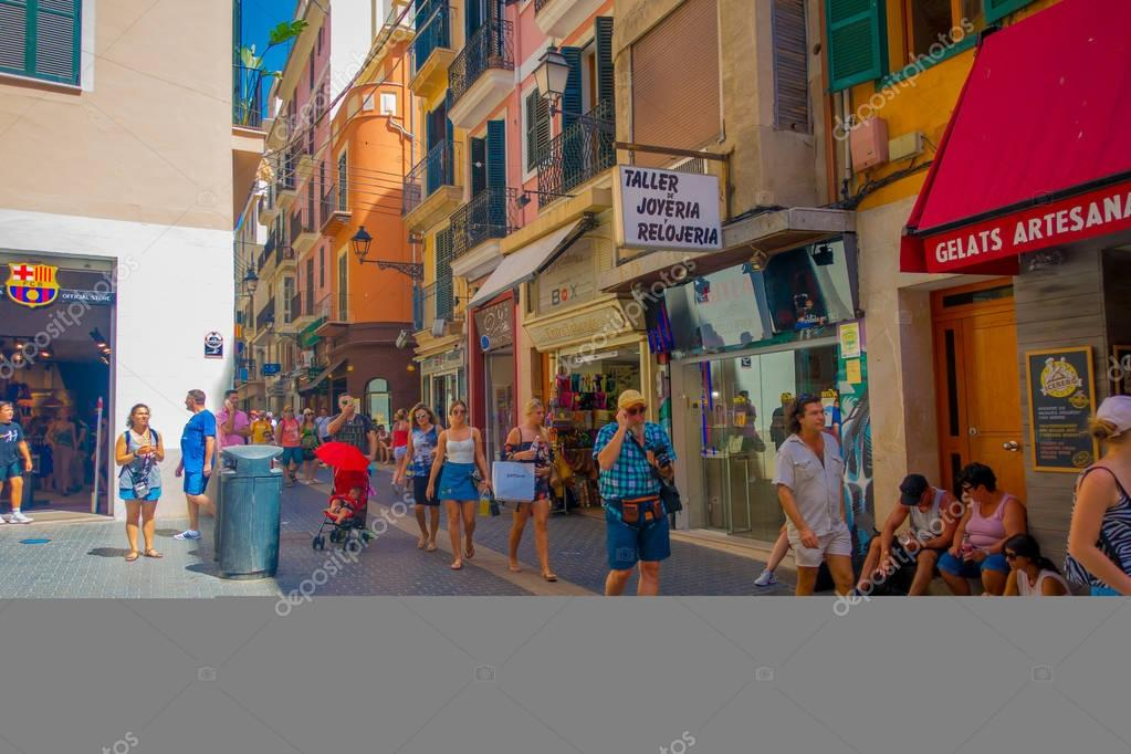 PALMA DE MALLORCA, SPAIN - AUGUST 18 2017: Unidentified people walking and buying in the streets in old city of Palma de Mallorca, Spain
