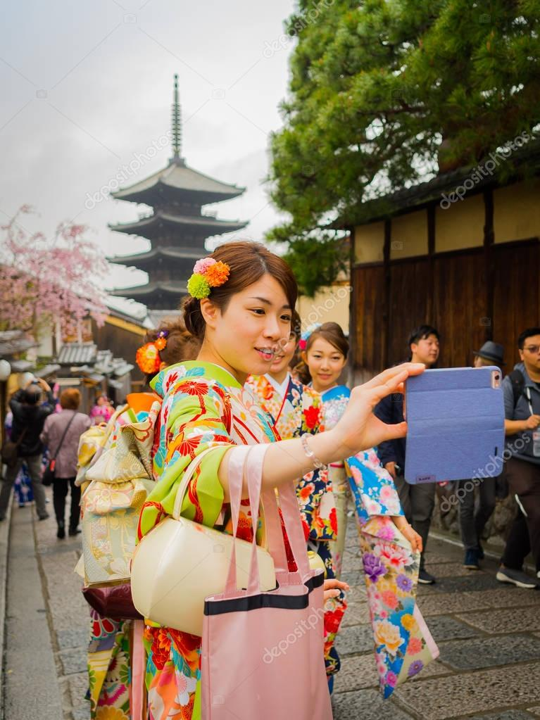 HAKONE, JAPAN - JULY 02, 2017: Unidentified women wearing a kymono and walking in the Higashiyama district with cherry blossoms the springtime in Kyoto