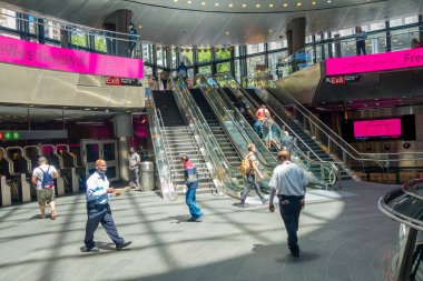 NEW YORK, USA - MAY 05, 2017: Unidentified people walking and enyoing the view, inside of Fulton Center unveiled by Metropolitan Transit Authority during opening ceremony on Broadway in Manhattan