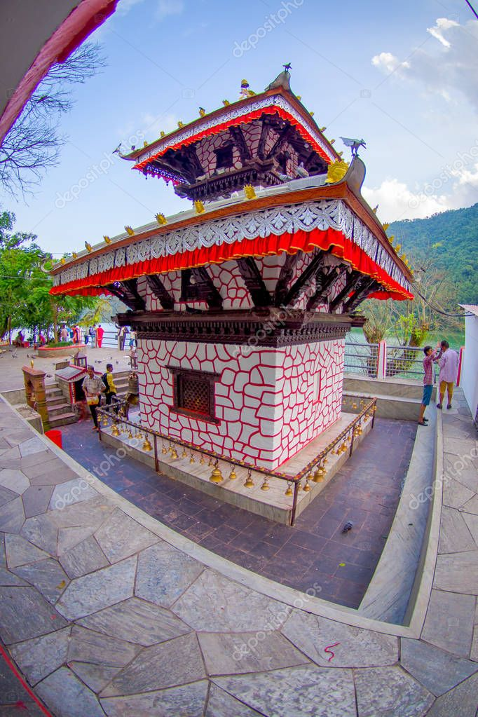 POKHARA, NEPAL - SEPTEMBER 04, 2017: Tal Barahi Temple, located at the center of Phewa Lake, is the most important religious monument of Pokhara, fish eye effect