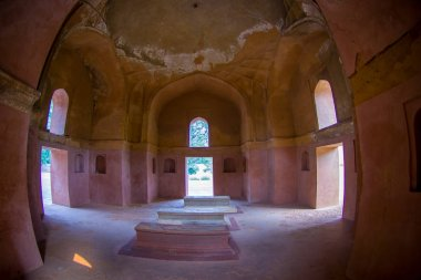 DELHI, INDIA - SEPTEMBER 19, 2017: Beautiful indoor view of some tombs of Isa Khan Tomb at Humayuns Tomb complex in Delhi, India. Humayuns Tomb was the first garden-tomb on the Indian subcontinent