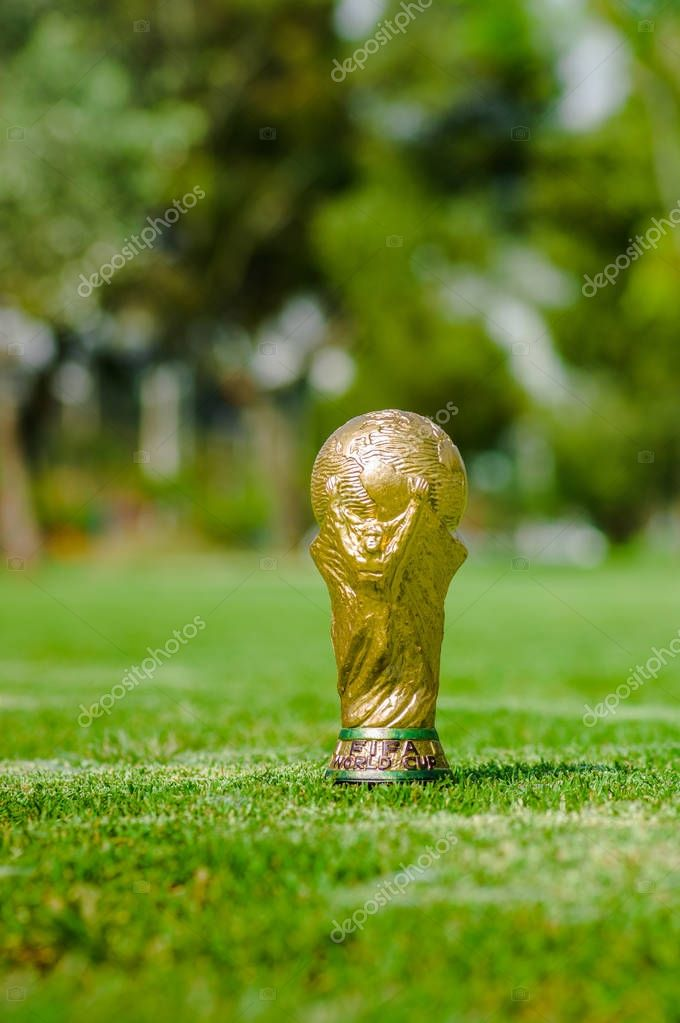 Close up of of fake golden trophy in the form of the globe in the park