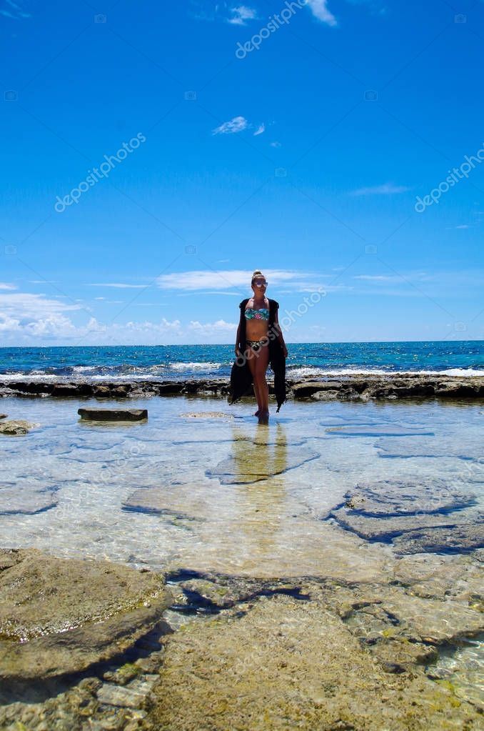 JOHNNY CAY, COLOMBIA - OCTOBER 21, 2017: Unidentified woman enjoying the beautiful sunny day in the coast of Johnny Cay island
