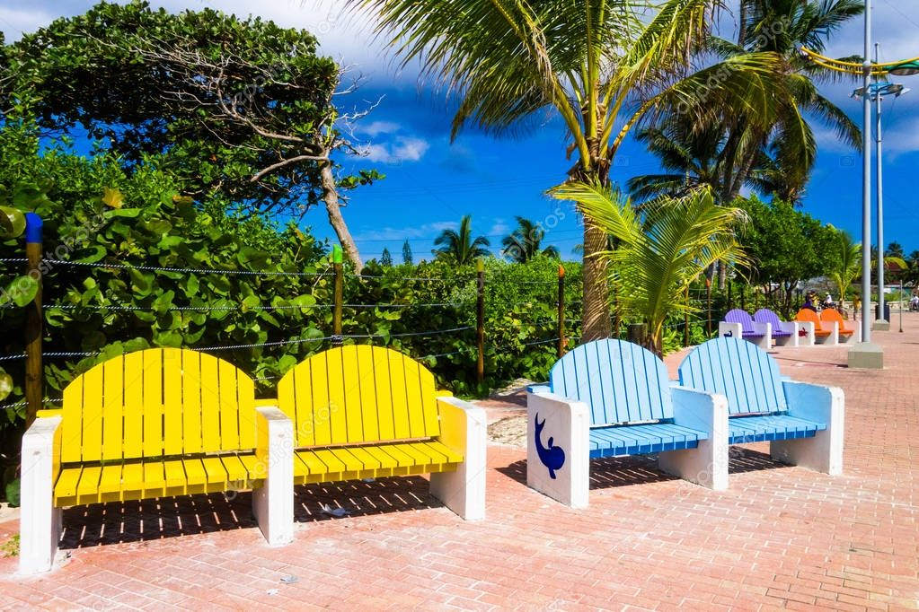 SAN ANDRES, COLOMBIA - OCTOBER 21, 2017: Close up of colorful public chairs, yellow and blue in a boulevar in San Andres, Colombia