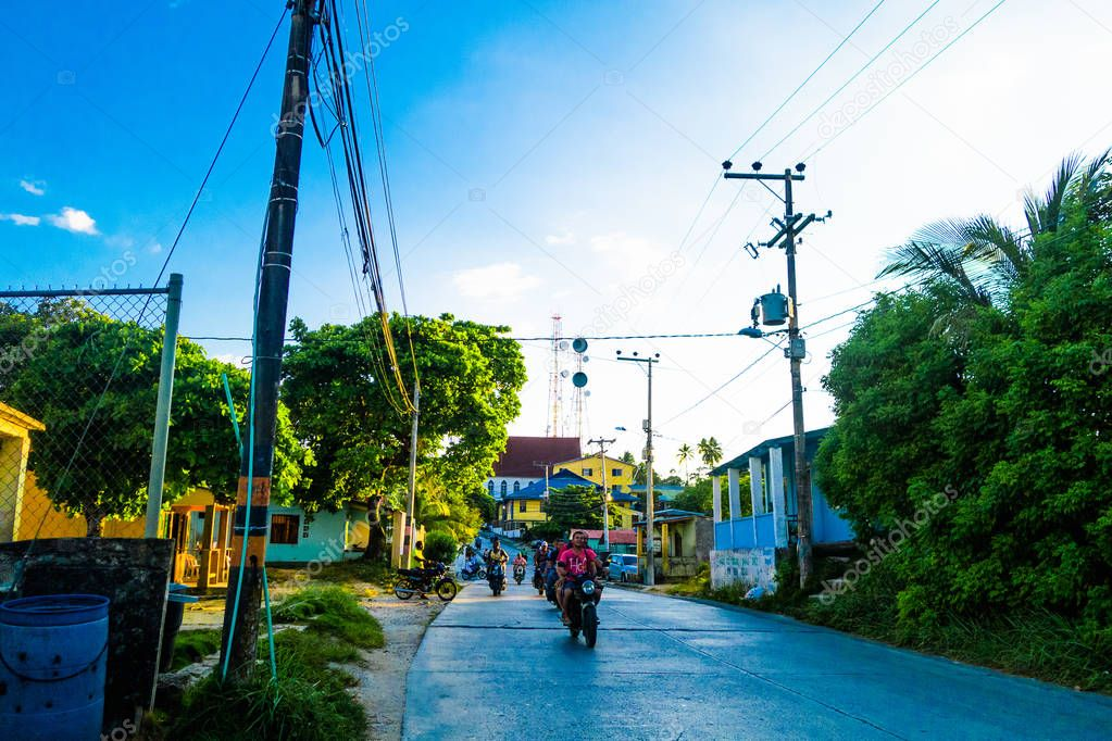 SAN ANDRES, COLOMBIA - OCTOBER 21, 2017: Outdoor view of unidentified people riding their motorbikes in the streets in San Andres, Colombia in a beautiful day