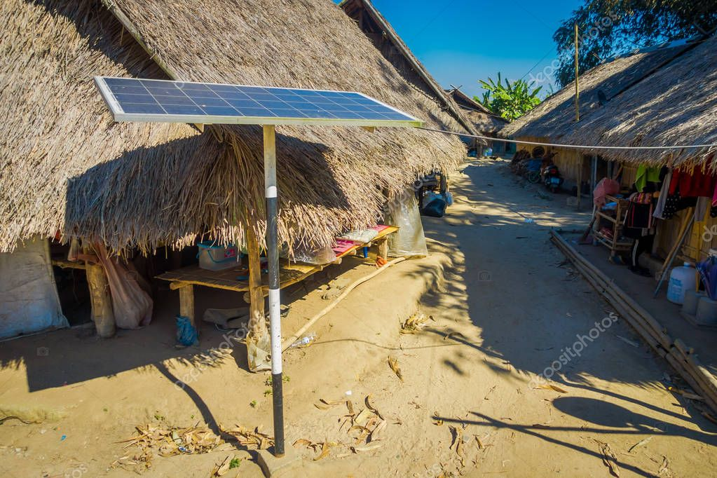 CHIANG RAI, THAILAND - FEBRUARY 01, 2018: Outdoor view of solar pannel close to traditional houses of Long Neck trib, Kayan Lahwi, northern Thailand