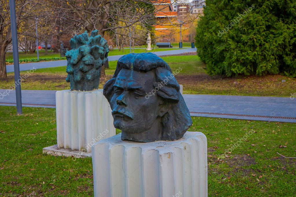MOSCOW, RUSSIA- APRIL, 24, 2018: View of modern head sculptures in fallen Monument Park also known as Muzeon Park of Arts with relics of the Soviet Union USSR