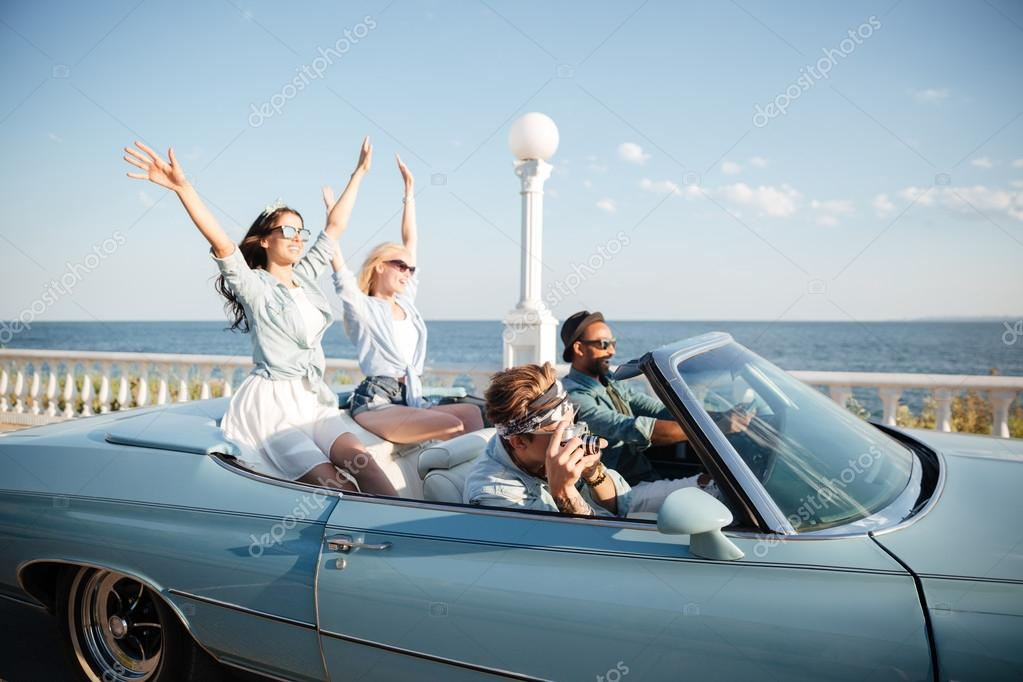 The Car Group >> Group Of Happy Young People Driving A Car Stock Photo