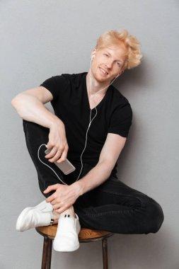 Cheerful caucasian man listening music