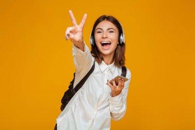 Portrait of a cheerful teenage schoolgirl