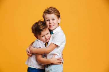 Happy little children brothers isolated