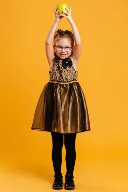Laughing girl child wearing princess crown