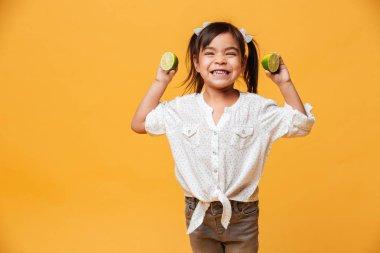 Little girl child holding lime.