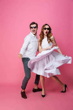 Full-length photo of young fashion couple in trendy stylish clot