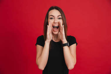 Portrait of an excited casual girl shouting