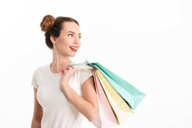 Portrait of a smiling casual girl holding shopping bags