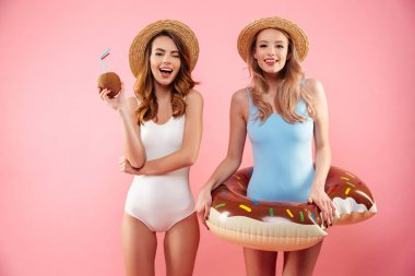 Portrait of a two pretty girls dressed in swimsuits