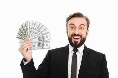Portrait of delighted rich male millionaire holding fan of money