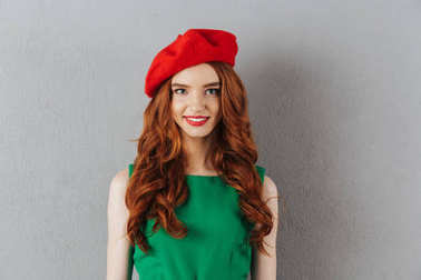 Redhead young happy lady in green dress