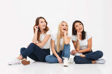 Young happy pretty girls friends sitting isolated