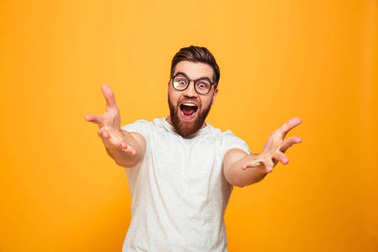 Portrait of an excited bearded man in eyeglasses