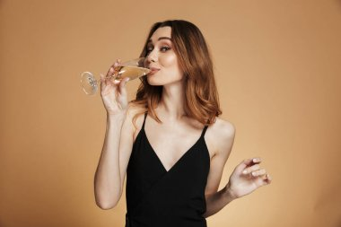 Happy pretty woman drinking champagne and looking camera