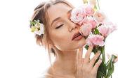 Ženský půl nahou dámu 20s hospodářství kytici krásných eustom