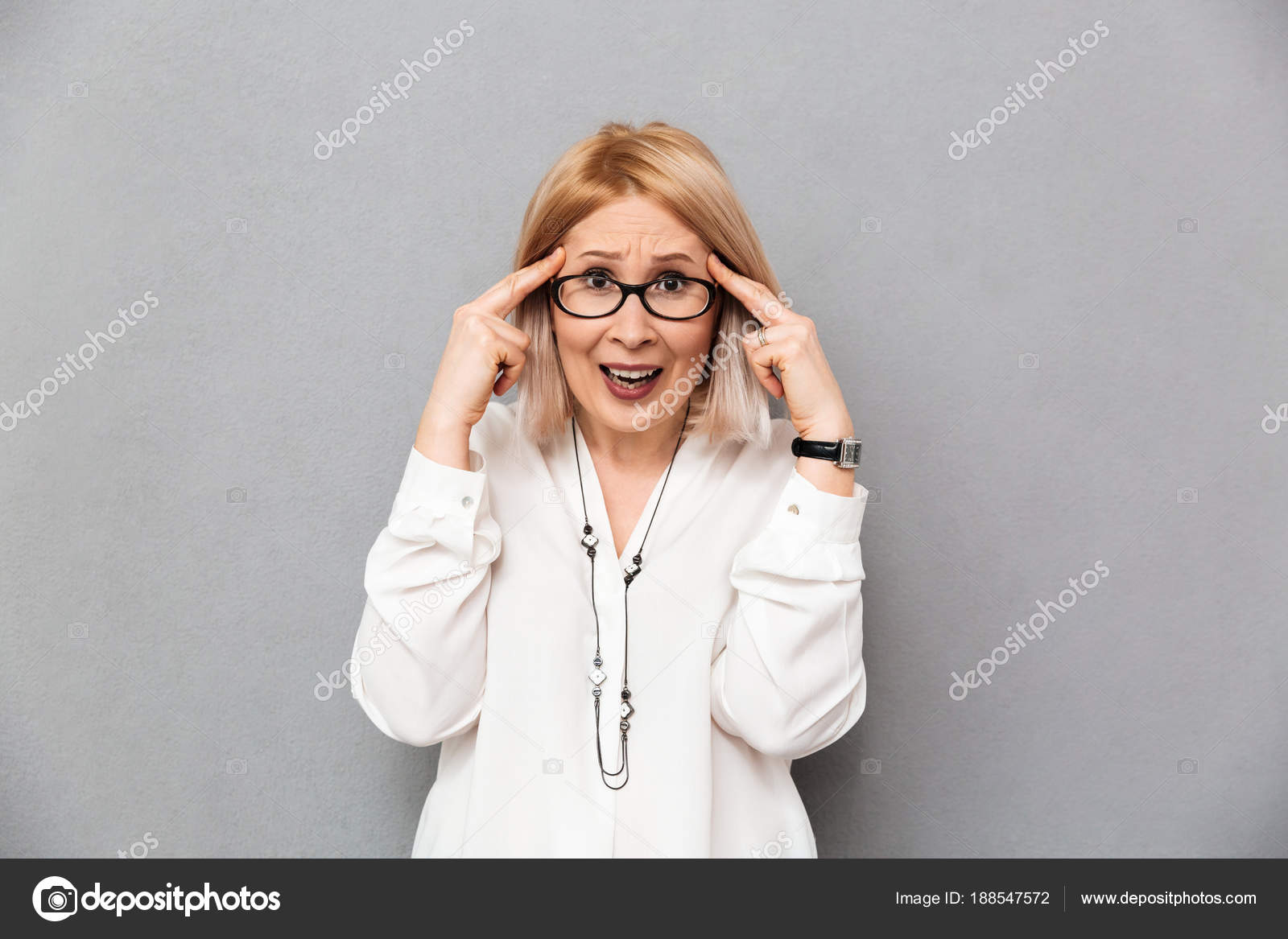 Portrait of smiling mature woman wearing glasses stockphoto