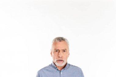 Shocked man looking camera while posing isolated over white